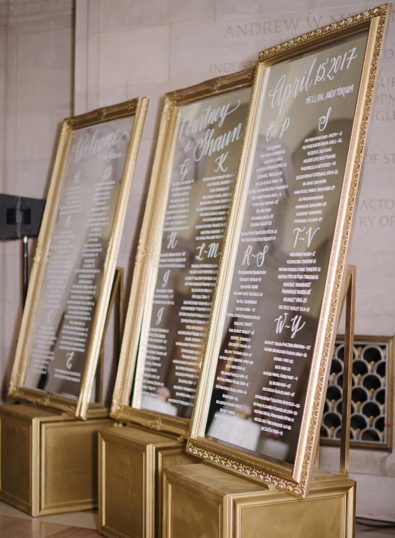 Calligraphed gold mirrors used as seating charts