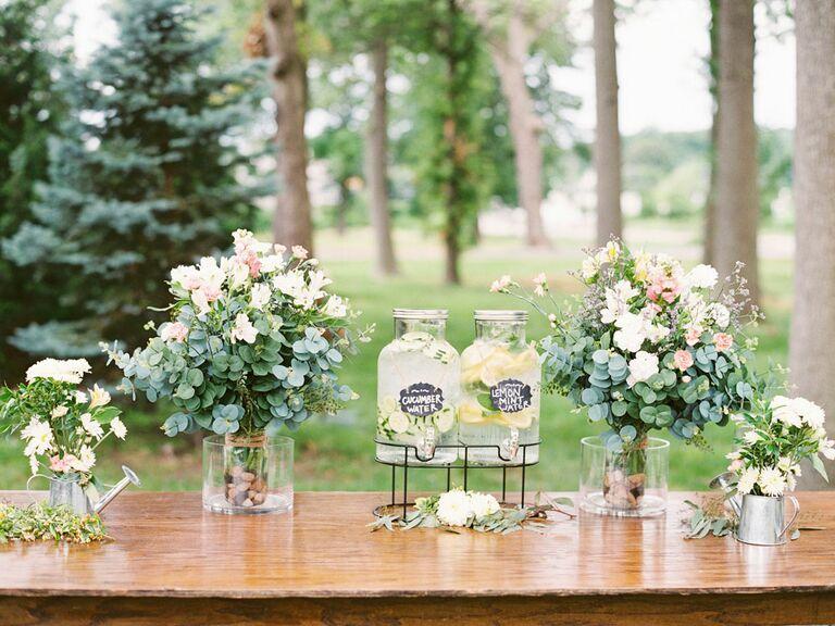 Flavored lemonade stand at outdoor summer wedding reception