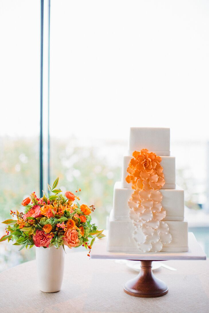 The couple's four-tier square cake was embellished with sugar flowers cascading down the side.