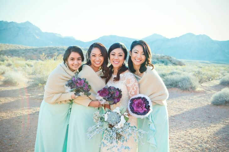 Bridesmaids wore mint green dresses, which really made the bright purple cabbage flower bouquets pop.