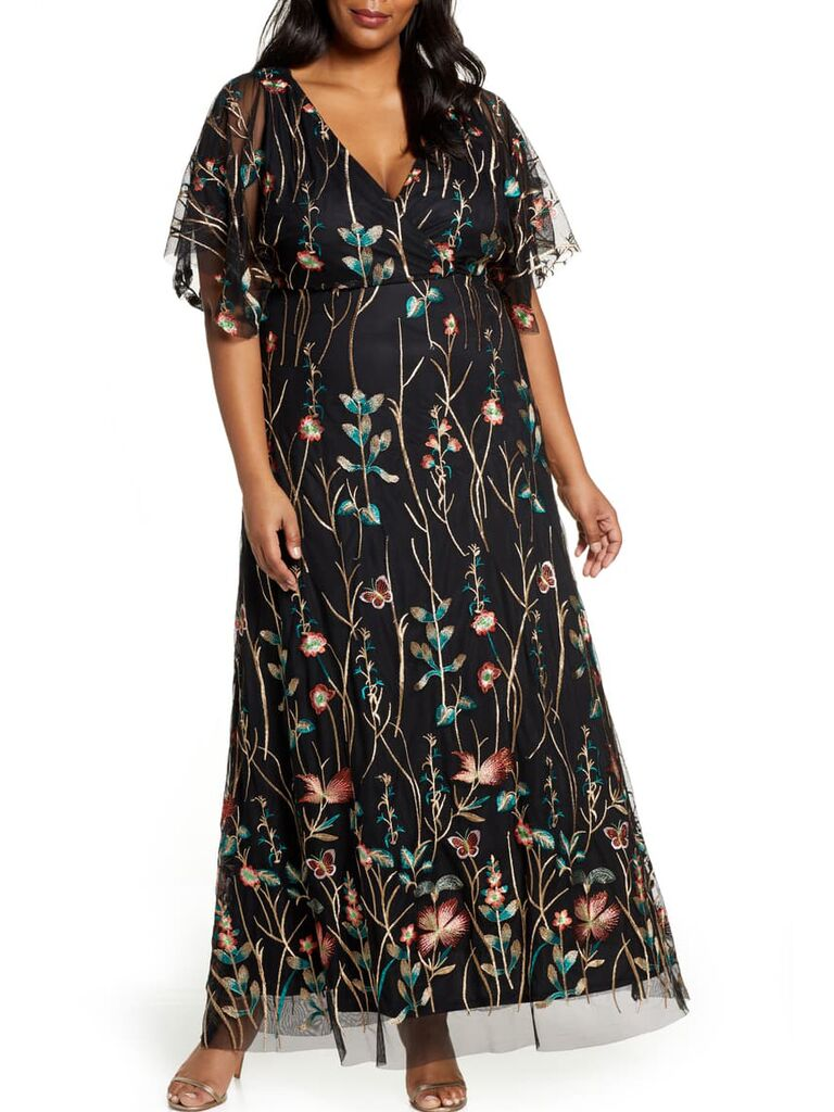 Black plus size maxi dress with sheer overlay and floral embroidery