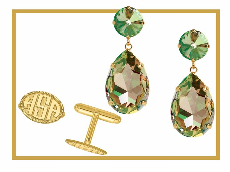 A set of monogrammed cuff links and green drop earrings