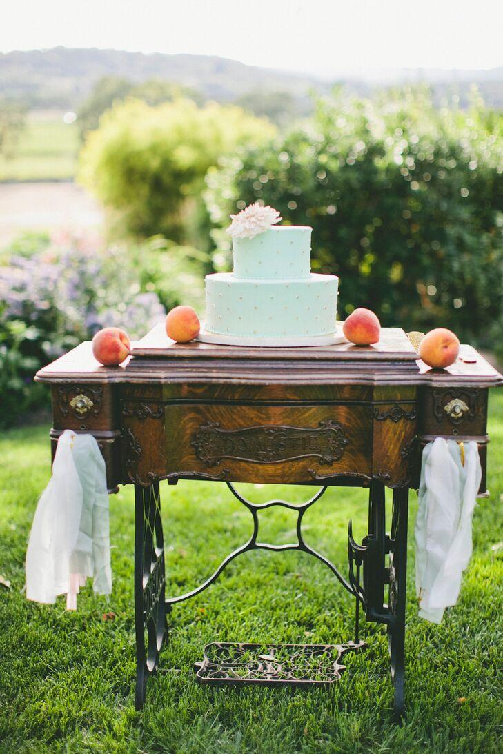 Pretty Please Bakeshop whipped up a playful pale blue confection as a post-dinner treat for Molly and Patrick's guest. The two-tiered wedding cake was decorated with cream-colored polka dots and displayed atop an antique sewing machine.