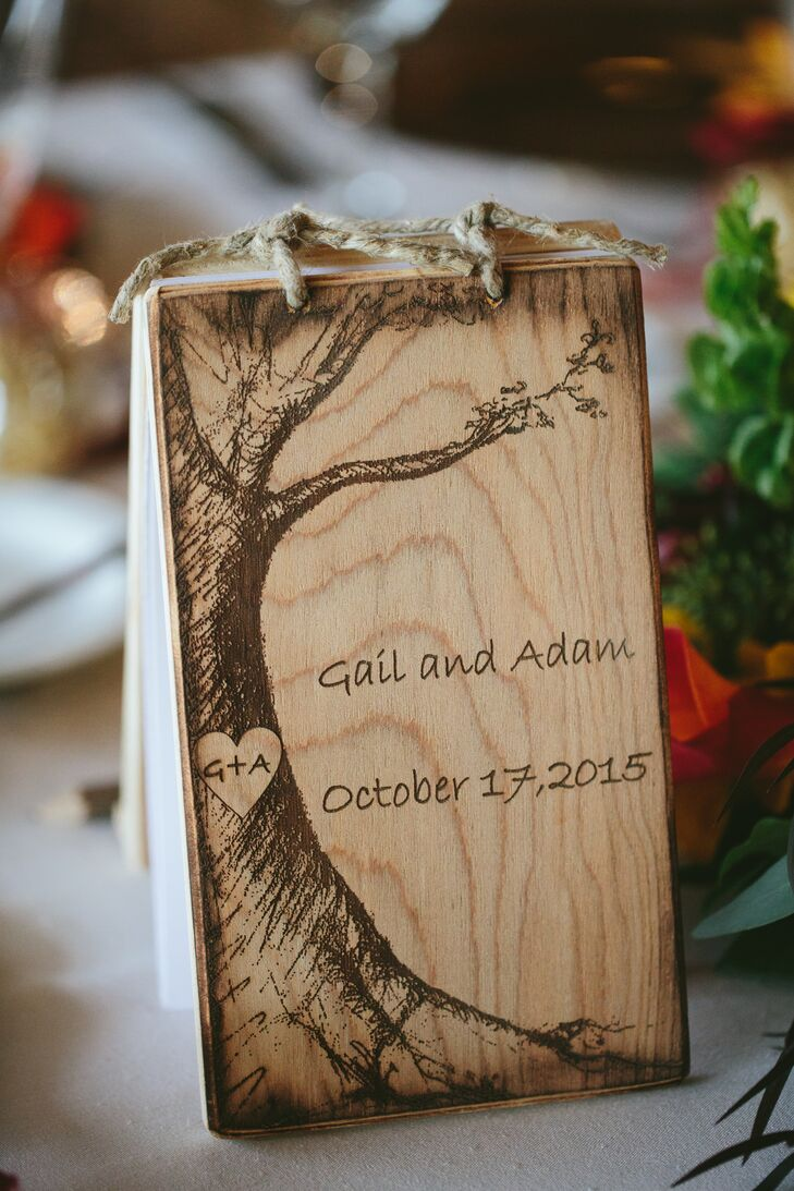 Guests found their seats via custom wood-burned table numbers that also served as miniature guest books.