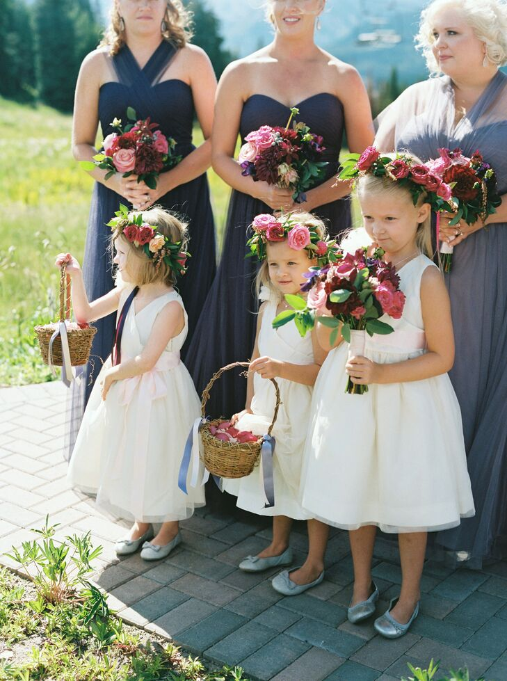 The three flower girls were nieces and children of the couples' friends. They wore flower garlands in their hair to match the bridal bouquet.