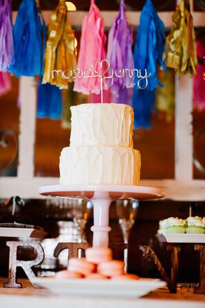 Buttercream Wedding Cake and Colorful Pom-Poms