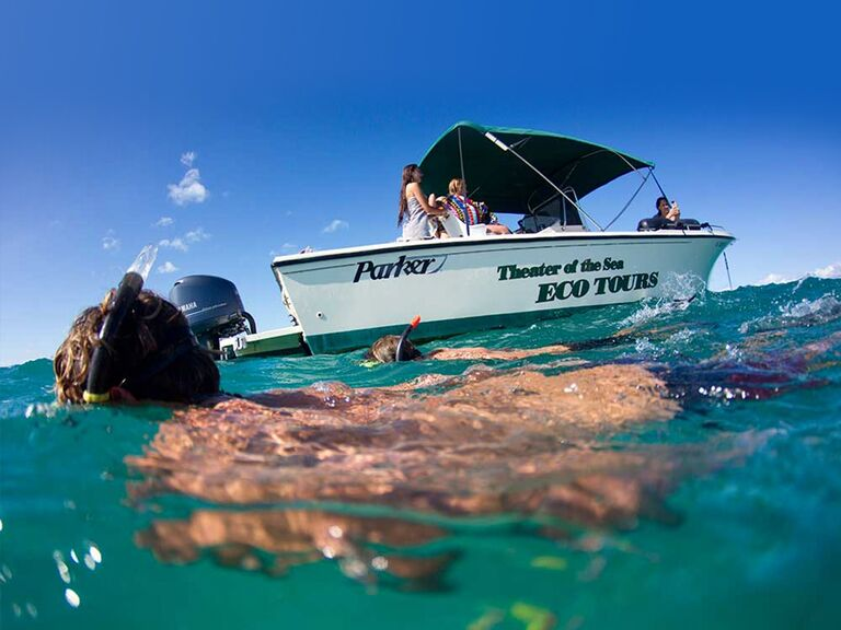 Boat on the water with two snorkelers
