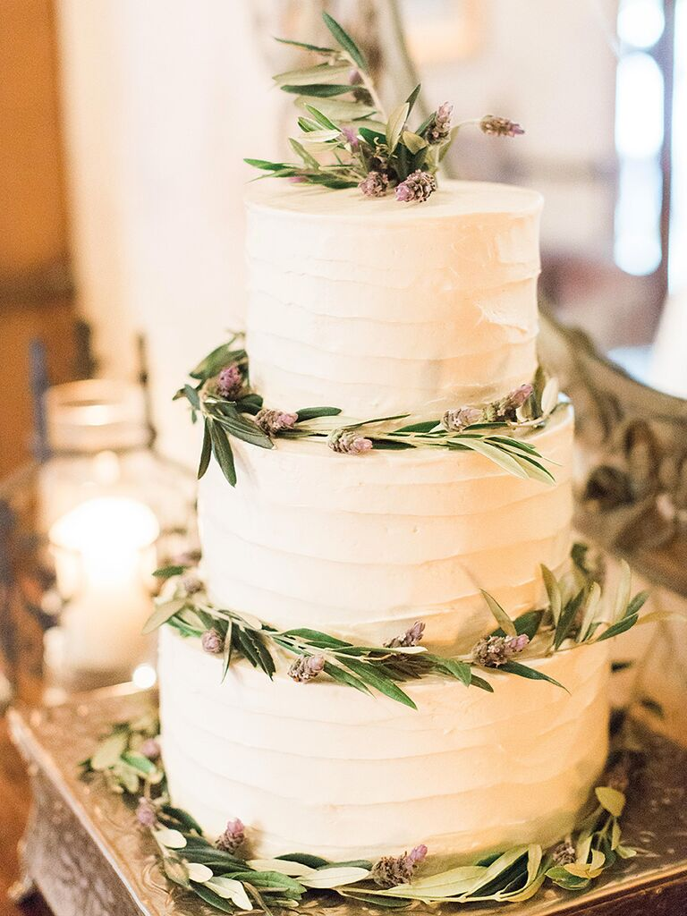 White wedding cake with lavender wreaths