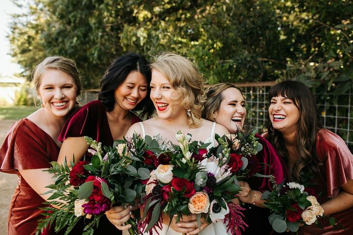 Bridesmaids with Modern Bouquets and Red Velvet Dresses