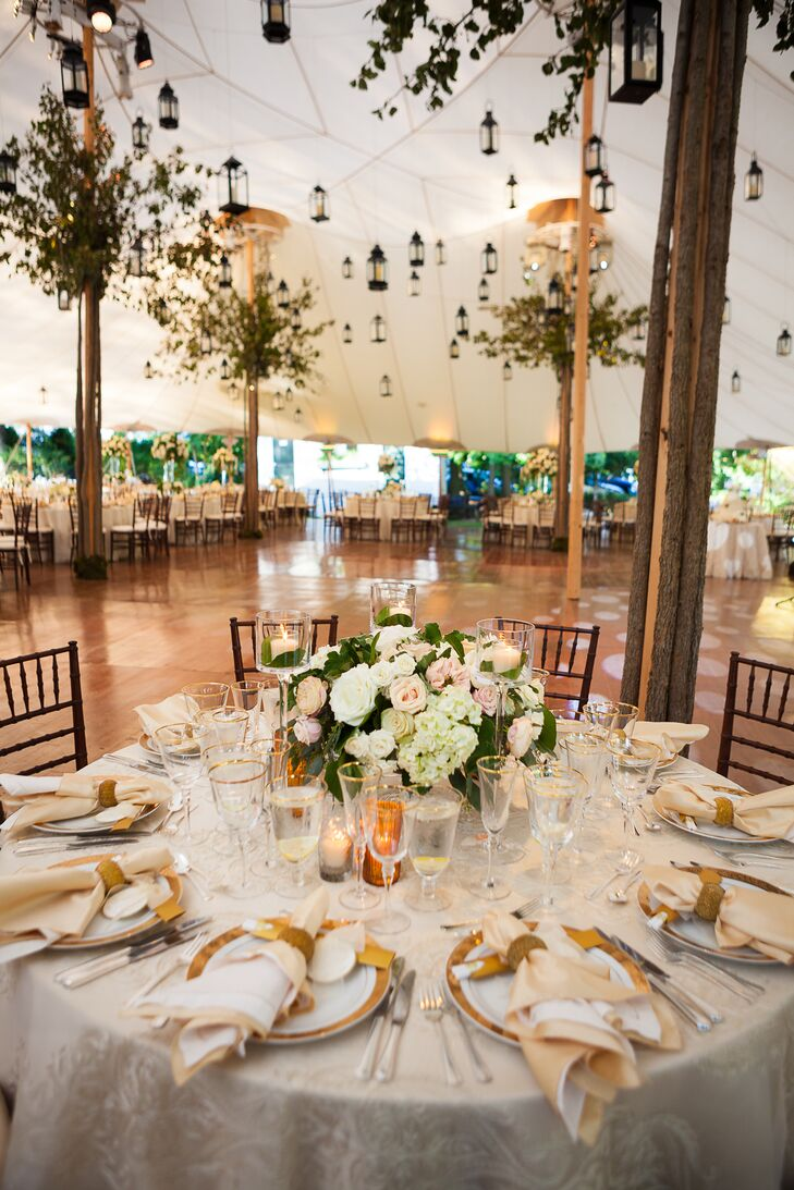 To balance the whimsical decor and garden-inspired floral arrangements, the couple dressed the tables in an elegant, old-world fashion with gold-rimmed China and stemware. Shimmery gold jacquard linens heightened the effect, while adding a note of glamour to the evening's aesthetic.