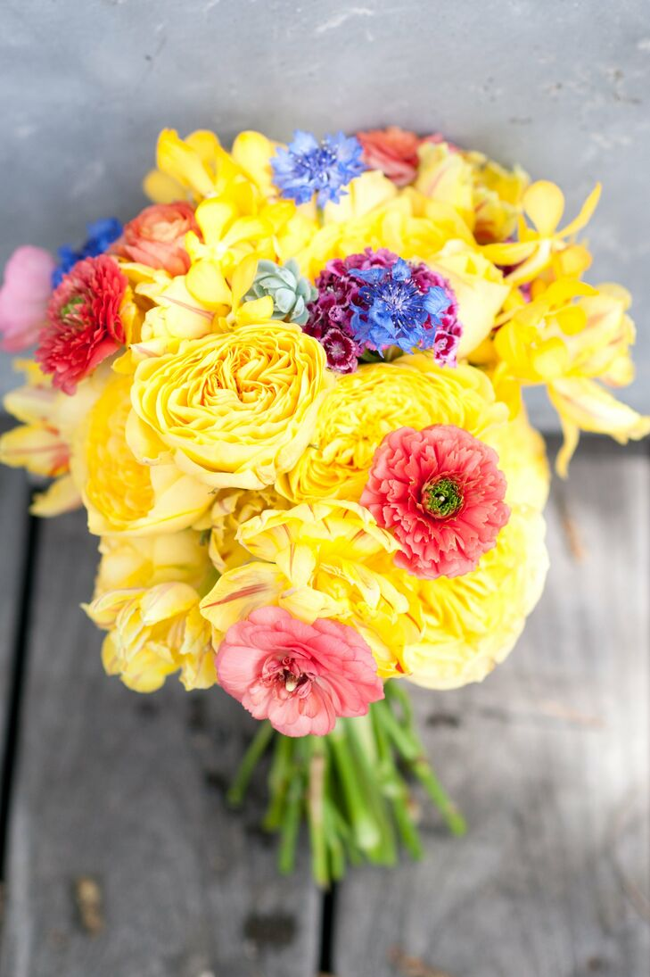 Sarah's sister carried a sunshine-yellow bouquet that included garden roses and orchids.