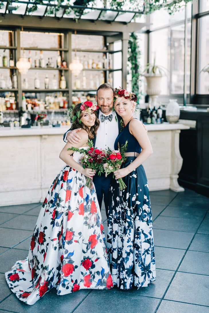 "Alexia's bridesmaids—Jason's two daughters—donned dramatic floral gowns in bold shades of navy and burgundy for the modern rooftop affair. While the trio originally contemplated garnet sequin minidresses and long-sleeve, backless gowns, they kept going back to striking printed ball gowns. They paired the dresses with romantic red flower crowns for a whimsical, bohemian aesthetic. ""They both looked fabulous,"" Alexia says."