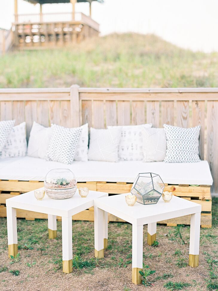 Instead of having a traditional seated dinner, Taylor and Caleb set up pallet couches and cocktail tables for guests to eat at. The couches were accompanied by small accent tables decorated with geometric terrariums and gold mercury glass votives.