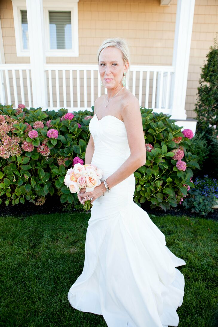 Jenna wore a classic Pronovias wedding dress in the Alma style. The dress was strapless with a sweetheart neckline and a fit-and-flare shape. Jenna accented it with a Cara New York rhinestone belt from Nordstrom.