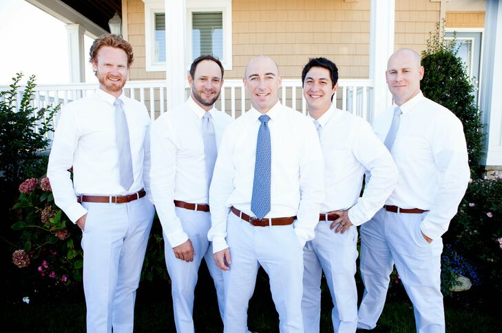 Justin and his groomsmen wore white button-up shirts with gray pants from J.Crew in keeping with the casual wedding style. Justin wore a blue tie from Vineyard Vines; his groomsmen's ties were a lighter shade of blue and from Nordstrom.