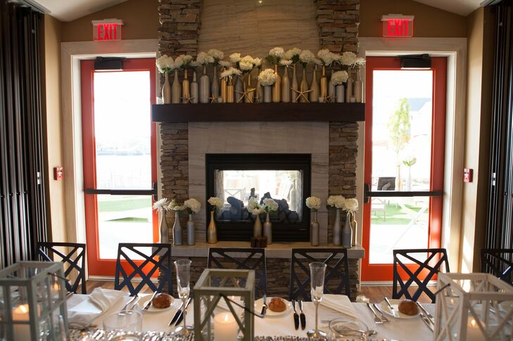 Before the wedding, Jenna collected numerous wine bottles and painted them different shades of gold and silver. They were placed on the fireplace mantel and on the cocktail tables at the reception at the Reeds at Shelter Haven.
