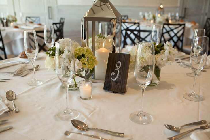 """Jenna and Justin decorated their reception tables with lanterns, small white floral arrangements and warm candlelight. """"I was very lucky to be able to use some of my own belongings to decorate the reception,"""" Jenna says. """"Many of the lanterns that were used as centerpieces were just accents we had in our home."""""""