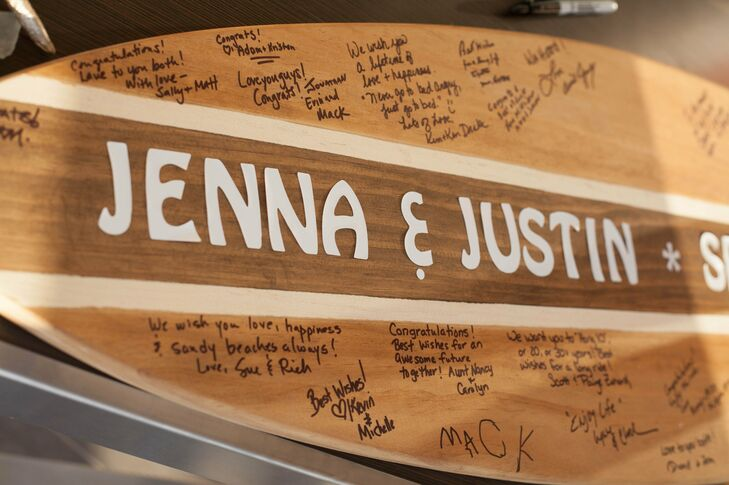 """Instead of a traditional guest book, Jenna and Justin kept with their beach theme and had their guests sign their names and loving words on a custom wooden surfboard that had """"Jenna & Justin"""" down the middle."""