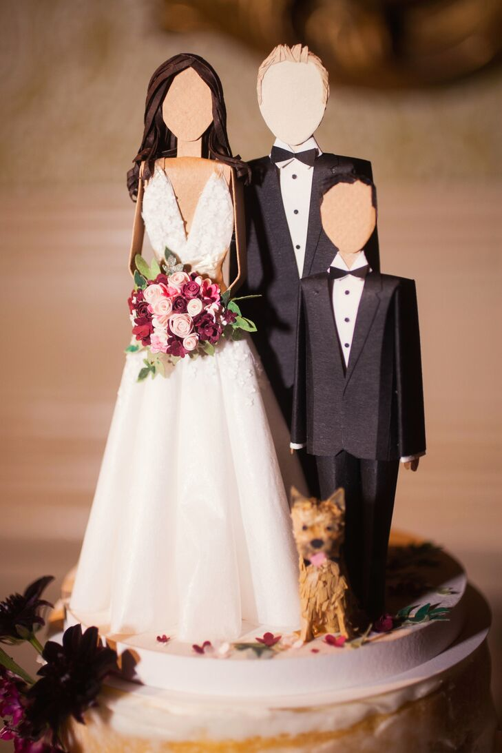 The cake topper, designed by Concarta, included models of the bride, groom, son of bride and family dog. Each character was carefuly made to represent their actual look with great detail—even the bride's dress and hair were matched perfectly!