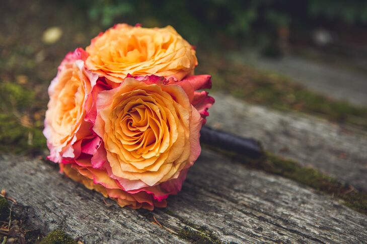 Each bridesmaid carried an orange color or orange inspired bouquet of different flowers.