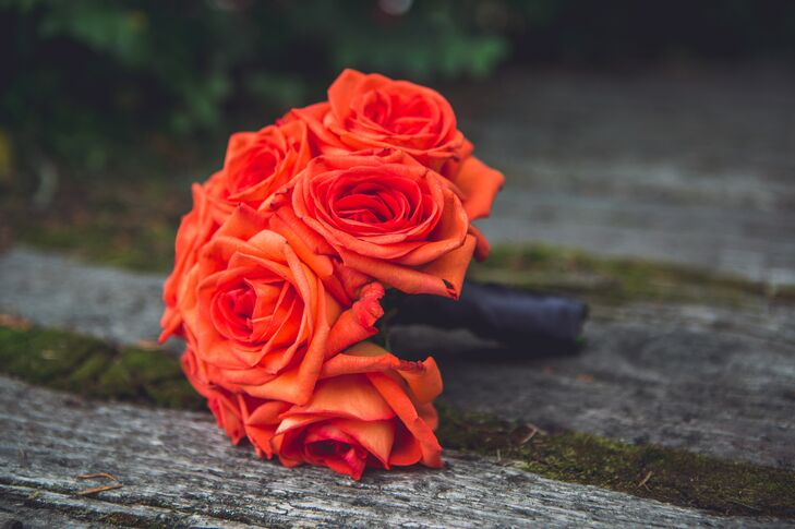 Each bridesmaid carried an orange bouquet of different flowers.