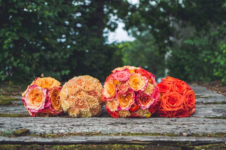 The bridal party carried bright orange bouquets, adding a burst of color to their bridal style.