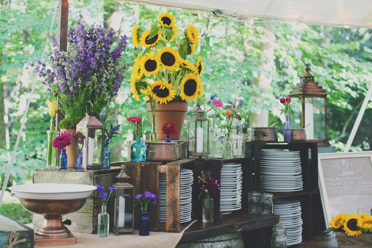 The plates for the buffet style dinner were displayed in wooden crates alongside large arrangements of sunflowers.