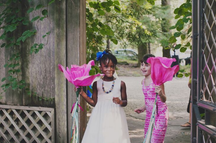 Ariel and Golden had two flower girls (her niece, Taylor and Golden's cousin, Alanna) who carried life-sized paper mache flowers down the aisle.