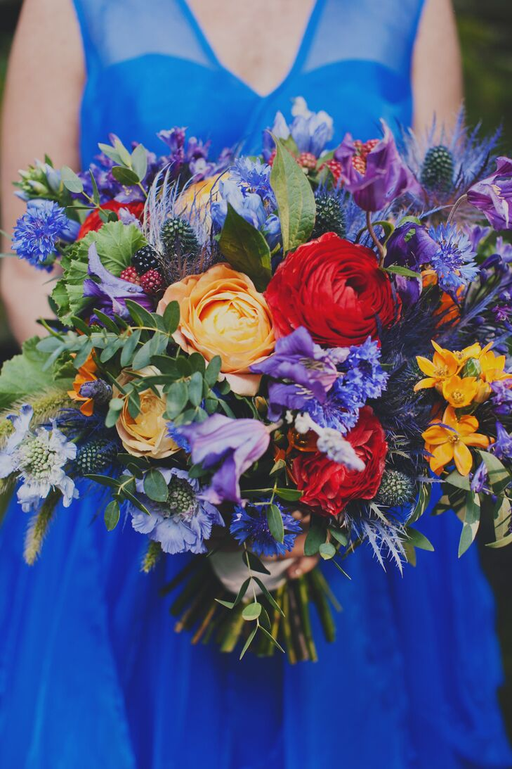 """""""My bouquet was gorgeous!"""" says Ariel.  She carried a vibrant bunch of delphinium, thistle, white dahlia and lavender in earthy shades of blue, yellow and orange. With accents of blueberries and raspberries."""