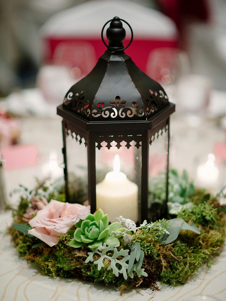 Romantic wedding centerpiece with lanterns and roses