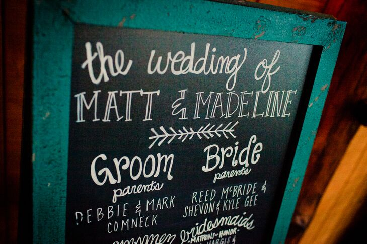 To welcome guests to the ceremony at Spruce Mountain Ranch in Larkspur, Colorado, Madeline and Matt wrote the program onto a teal-wood-framed chalkboard. The flowing writing and turquoise color totally matched the day's look and feel.