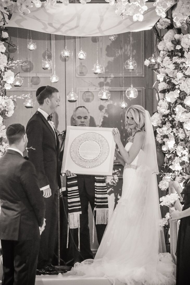 Bride and Groom Holding the Ketubah During Jewish Ceremony