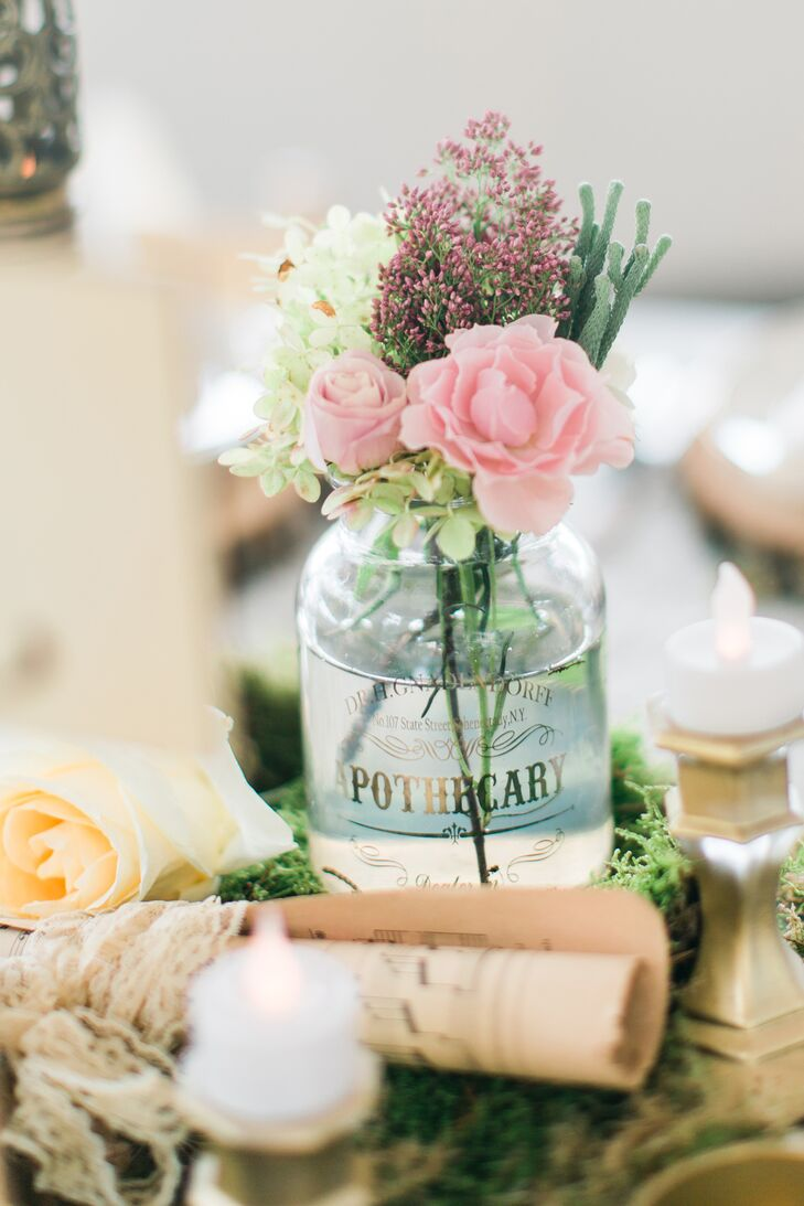 Pastel blooms were placed in glass apothecary jars as an alternative to traditional bud vases.