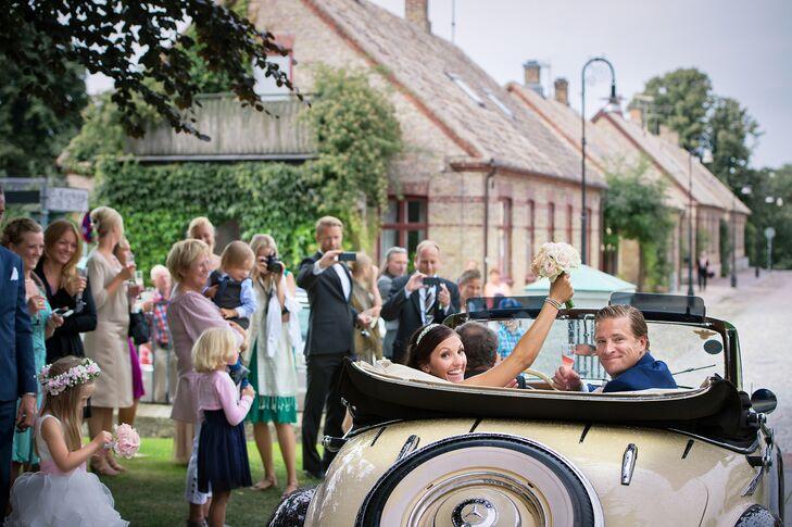Bride and Groom Exit in Classic Vintage Cream Car