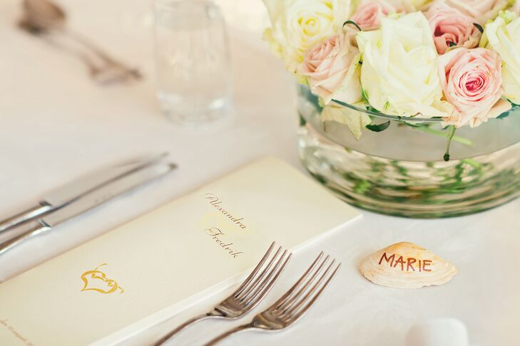 The couple used seashells for place cards, inspired by their proximity to the ocean.
