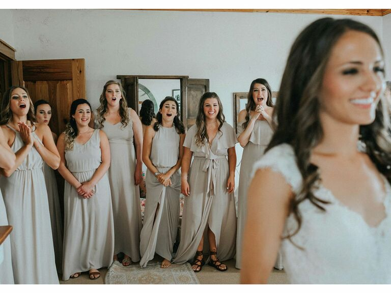 First look with bridesmaids on wedding morning