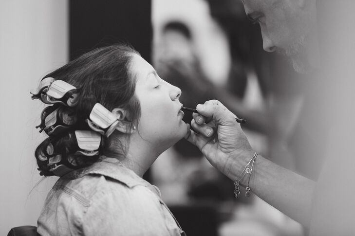 Bride Getting Ready as Stylist Applies Makeup