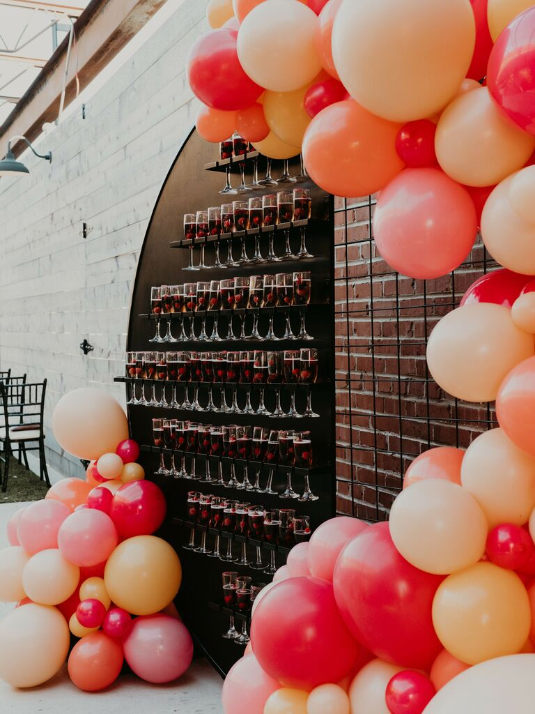 how to honor loved one at wedding wall with champagne glasses for toast