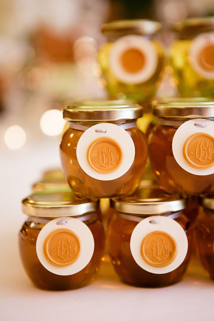 "Post-reception, the newlyweds passed out jarred honey favors with a wax monogram of their initials. ""The honey came from the hive of the groom's mother, so it was jarred with love,"" the bride says."