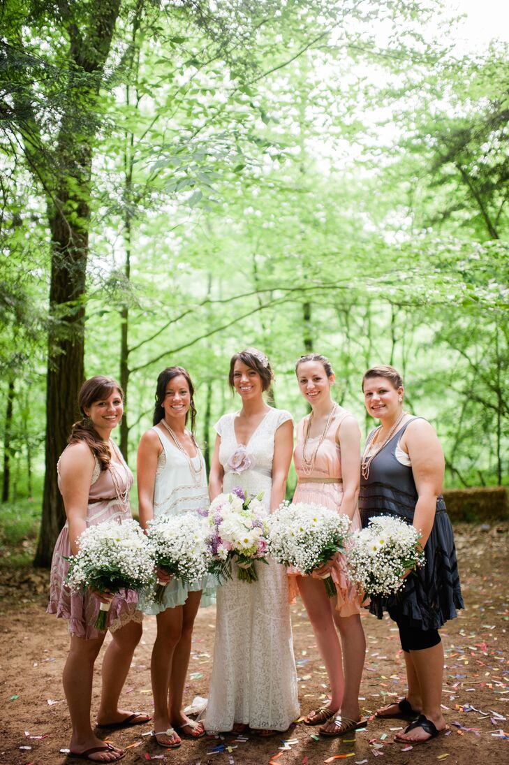 The bridesmaids carried baby's breath bouquets mixed with tiny white daisies. They wore mismatched bohemian dresses from Free People, each styled according to their comfort and personal preference.