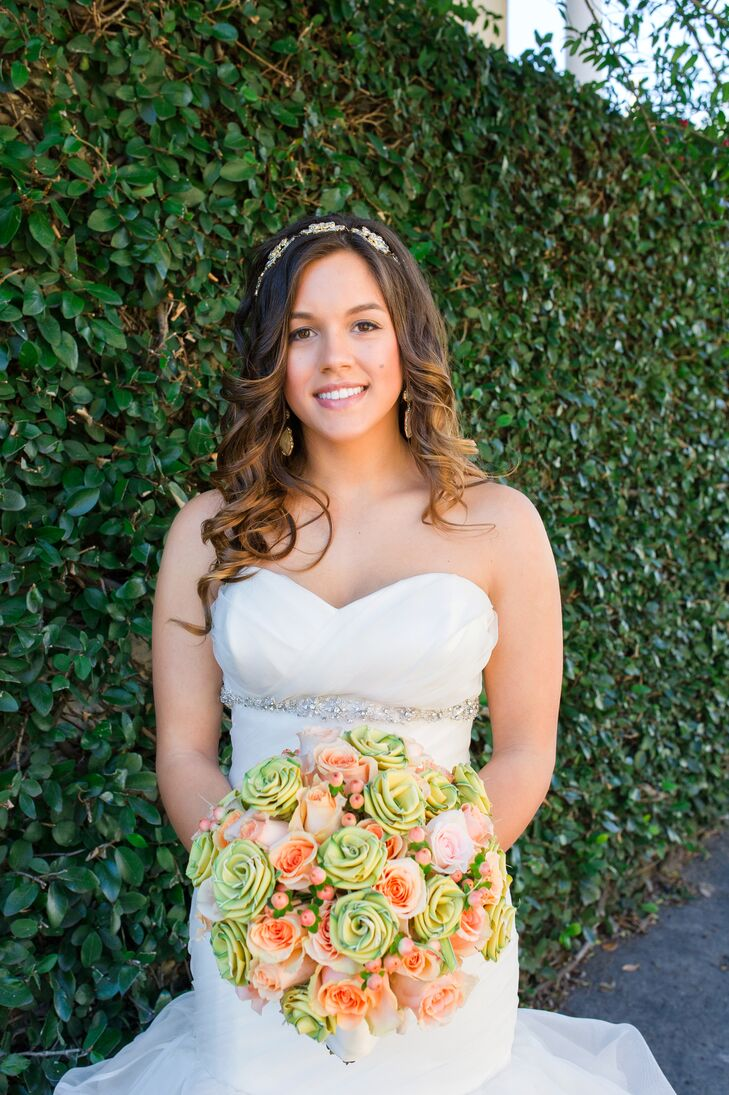 The bride carried a colorful bouquet of sweetgrass roses, peach hypericum berries and peach roses.