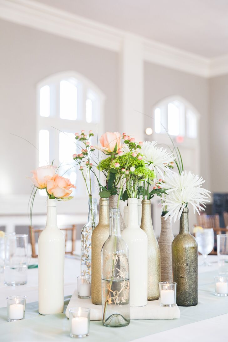 The couple painted a variety of wine bottles in shades of cream and gold for their eclectic tablescape.