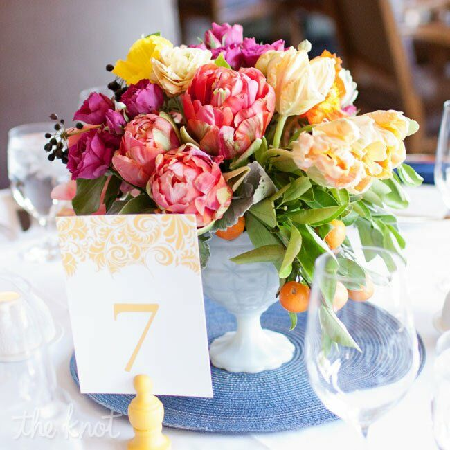 Fluffy fuchsia, pink and yellow arrangements perfectly aligned with the mood of the day.