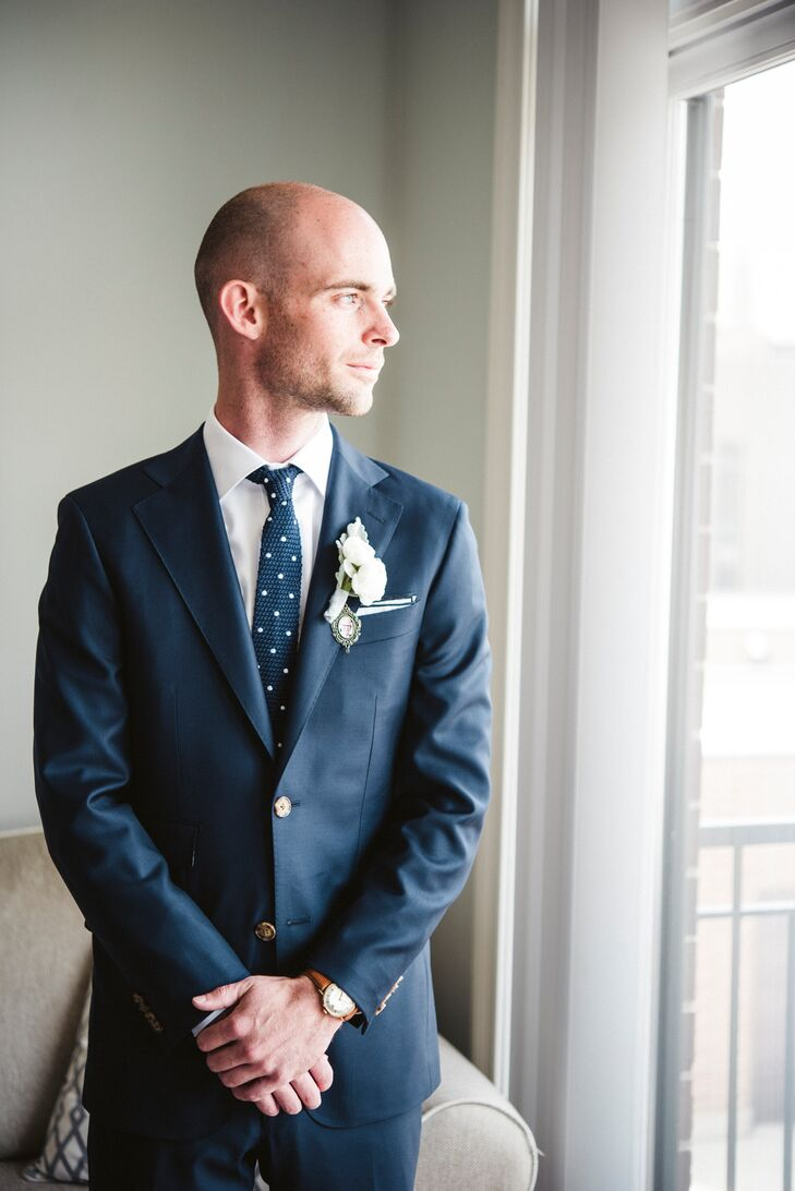"Matt's navy suit was custom-made at Formally Modern—and, in memory of his father, who had recently passed away—had ""Son of Jack"" embroidered into the lining of his jacket. Another way he honored his dad was by wearing a small photo of him in a pendant under his boutonniere. ""That way, his father would be close to his heart during the wedding,"" Lydia says."