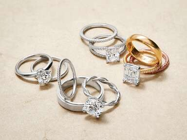 Silver and gold engagement rings and engraved bands