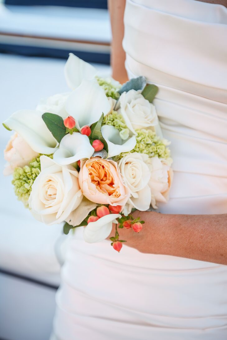The bride carried a summer-inspired bouquet made from peonies, roses and calla lilies.