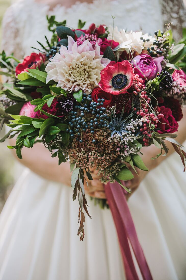 Rocket Science Events did a beautiful job creating pink and red florals, full of garden roses, ranunculus, anemones, berries and fruit—very appropriate for fall.