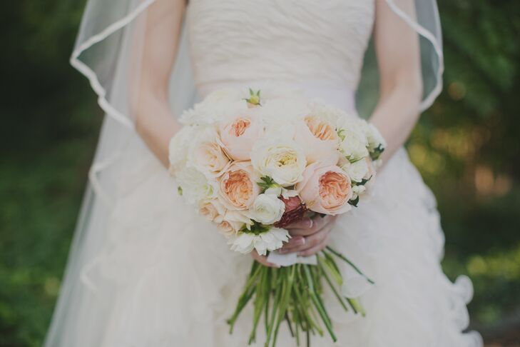 Kerry carried a feminine bridal bouquet of peach and ivory garden roses.