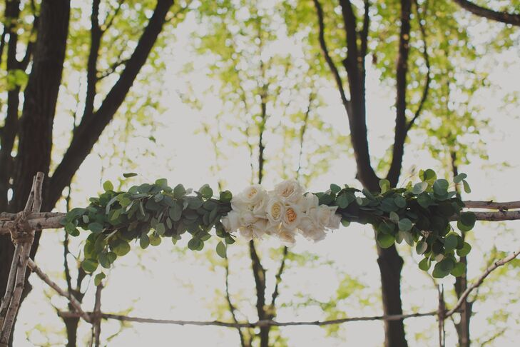 Kerry and Ilya were married beneath a wedding arch accented with fresh greenery and white roses.