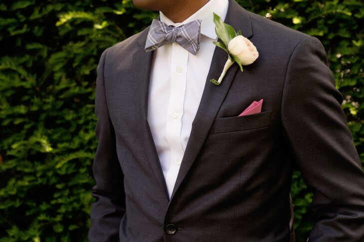Them men accessorized their dark gray suits with gingham bow ties and cranberry pocket squares to match the bridesmaid dresses.